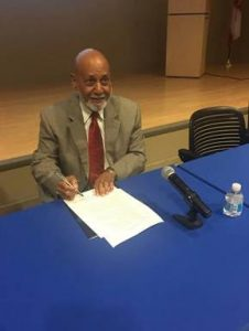 Congressman Alcee Hastings after signing the petition